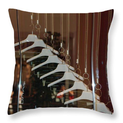 Hangers Throw Pillow featuring the photograph 10 Hangers by Rob Hans