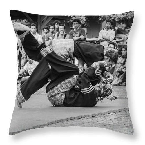 Martial Arts Throw Pillow featuring the photograph Pencak Silat by Arie Toursino