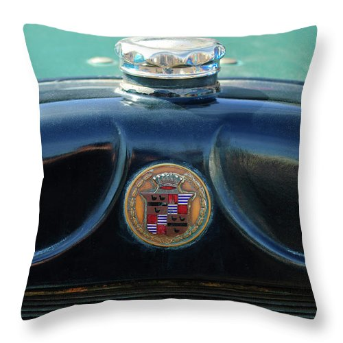 1925 Cadillac Throw Pillow featuring the photograph 1925 Cadillac Hood Ornament And Emblem by Jill Reger