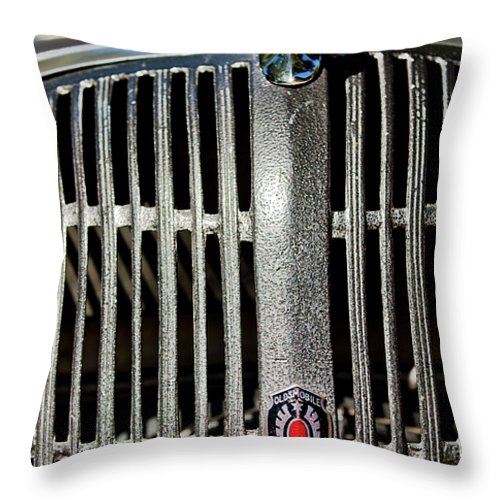 1936 Oldsmobile Throw Pillow featuring the photograph 1936 Oldsmobile Grille by Jill Reger