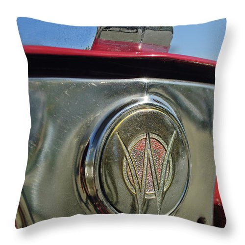 1949 Willys Jeepster Throw Pillow featuring the photograph 1949 Willys Jeepster Hood Ornament by Jill Reger