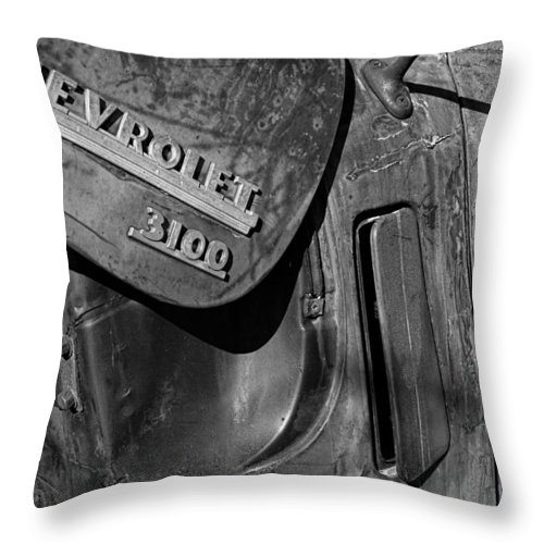1950 Throw Pillow featuring the photograph 1950 Chevrolet Truck Emblem Black And White by Nick Gray