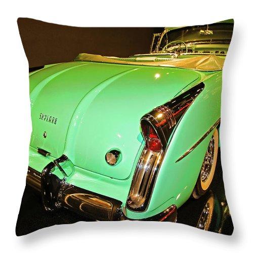 Classic Cars Throw Pillow featuring the photograph 1954 Buick Skylark Fins by John Bartelt