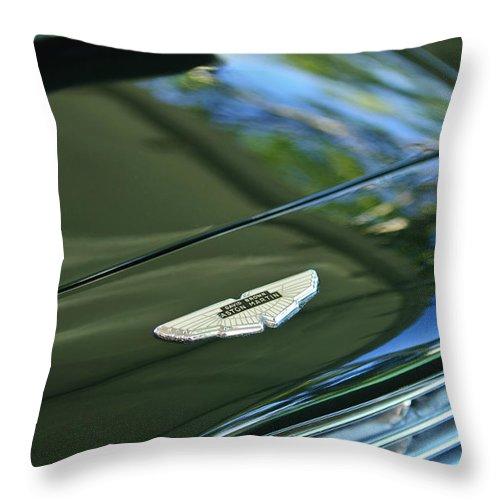 1967 Aston Martin Db6 Coupe Throw Pillow featuring the photograph 1967 Aston Martin Db6 Coupe Hood Emblem by Jill Reger