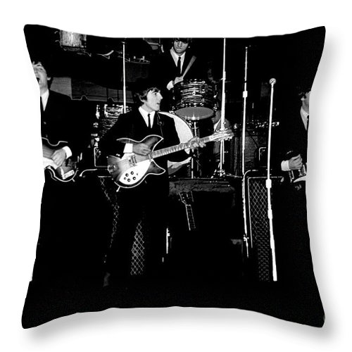 Beatles Throw Pillow featuring the photograph Beatles In Concert 1964 by Larry Mulvehill