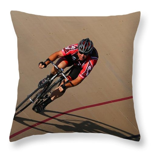 Pursuit Throw Pillow featuring the photograph Cycle Racing On The Curve by Douglas Sacha