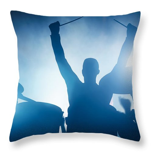 Drums Throw Pillow featuring the photograph Drummer playing on drums on music concert. Club lights by Michal Bednarek