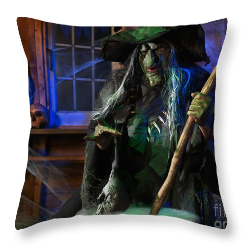 Witch Throw Pillow featuring the photograph Scary Old Witch With A Cauldron by Oleksiy Maksymenko