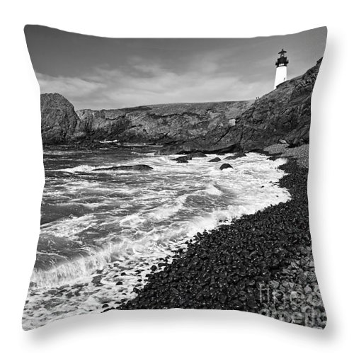 Yaquina Lighthouse Throw Pillow featuring the photograph Yaquina Lighthouse On Top Of Rocky Beach by Jamie Pham