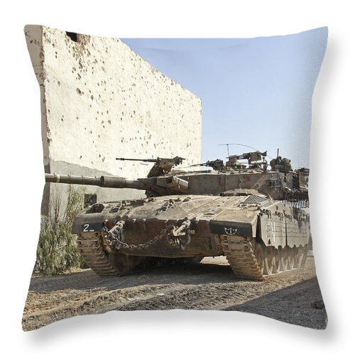Battletank Throw Pillow featuring the photograph An Israel Defense Force Merkava Mark II by Ofer Zidon