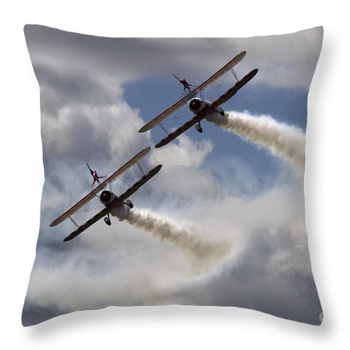 Windwalkers Throw Pillow featuring the photograph Windwalkers by Angel Ciesniarska