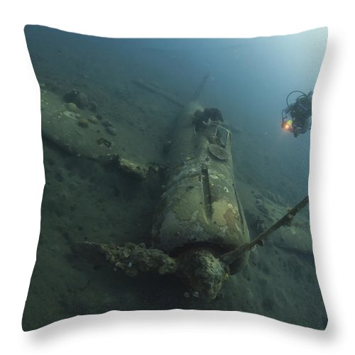 Kimbe Bay Throw Pillow featuring the photograph Diver Explores The Wreck by Steve Jones