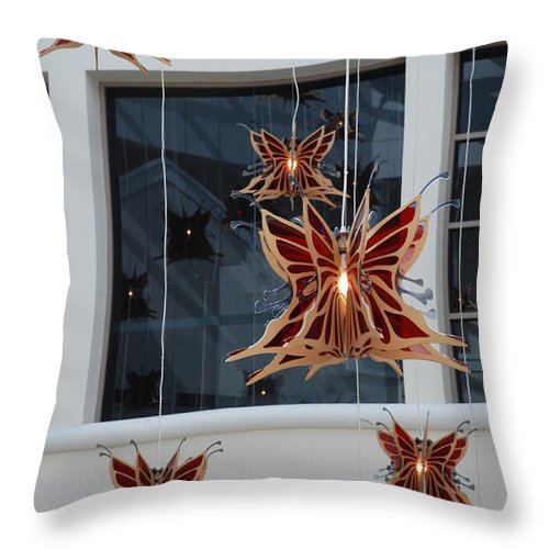 Architecture Throw Pillow featuring the photograph Hanging Butterflies by Rob Hans