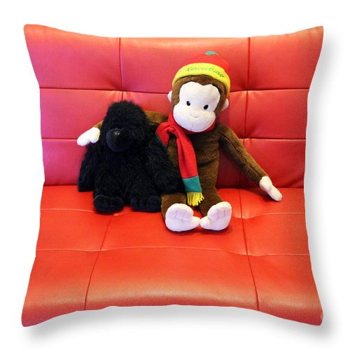 A Couple Of Monkeys Throw Pillow featuring the photograph A Couple Of Monkeys by Jennifer Robin