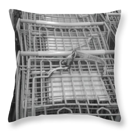 Grocery Cart Throw Pillow featuring the photograph A Hunters Gatherer by WaLdEmAr BoRrErO