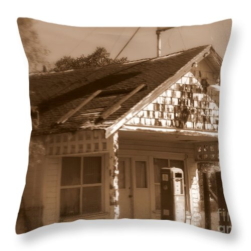 Old Building Throw Pillow featuring the photograph A Little Weathered Gas Station by Carol Groenen