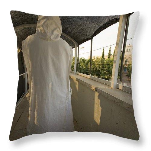 Nun Throw Pillow featuring the photograph A Nun In A Monastery by Danny Yanai