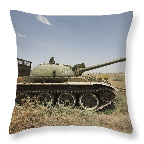 Turret Throw Pillow featuring the photograph A Russian T-62 Main Battle Tank Rests by Terry Moore