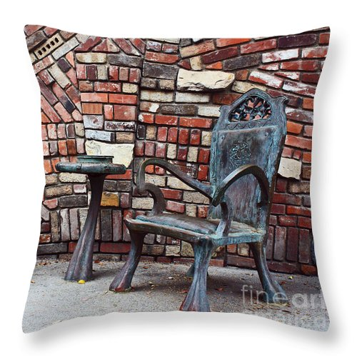 Bronze Chairs Throw Pillow featuring the photograph A Tranquil Moment by Kelly Holm