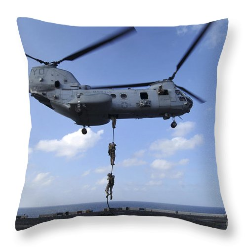 Fast Rope Throw Pillow featuring the photograph A Trio Of Marines Fast Rope by Stocktrek Images
