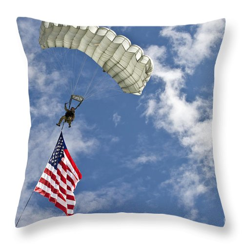 Flag Throw Pillow featuring the photograph A U.s. Air Force Member Glides by Stocktrek Images