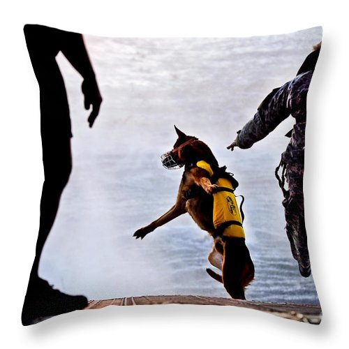 Military Throw Pillow featuring the photograph A U.s. Soldier And His Military Working by Stocktrek Images