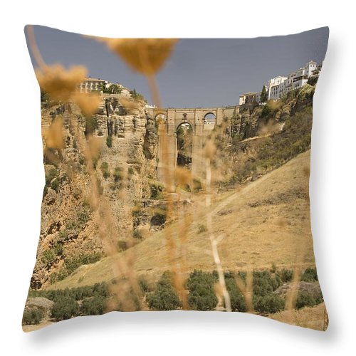 Tajo Throw Pillow featuring the photograph A View Of The Tajo De Ronda And Puente Nuevo Bridge Serrania De Ronda Andalucia Spain by Mal Bray