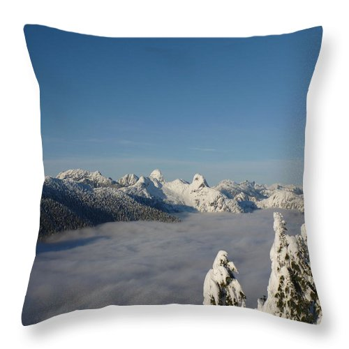 Winter Throw Pillow featuring the photograph Above The Clouds by Anders Skogman