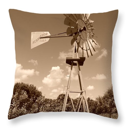 Sepia Throw Pillow featuring the photograph Aermotor Windmill by Rob Hans