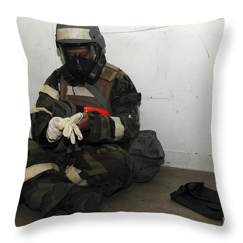 Military Throw Pillow featuring the photograph Airman Dons His Chemical Warfare by Stocktrek Images