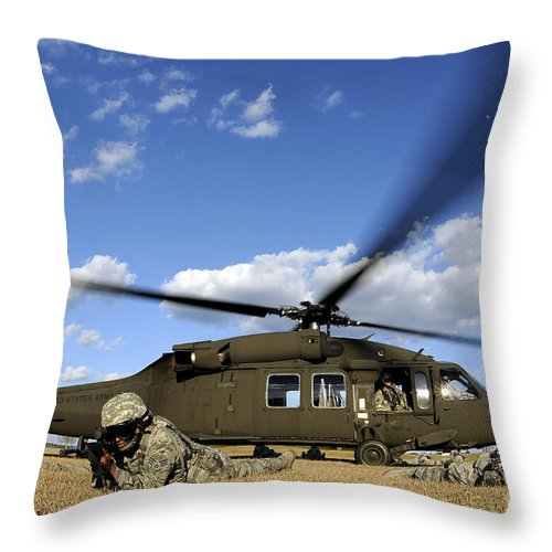 Us Air Force Throw Pillow featuring the photograph Airmen Provide Security In Front by Stocktrek Images