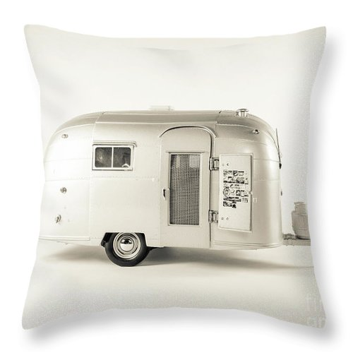 Camping Throw Pillow featuring the photograph Airstream Bambi Camper by Edward Fielding