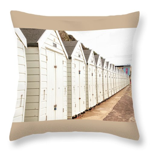 All In A Row Throw Pillow featuring the photograph All In A Row by Phyllis Taylor