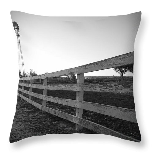Fence Farm Windmill Black And White Landscape Photograph Rustic Throw Pillow featuring the photograph Along The Fence by Kelly Wade