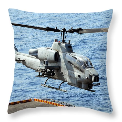 Military Throw Pillow featuring the photograph An Ah-1w Super Cobra Helicopter by Stocktrek Images