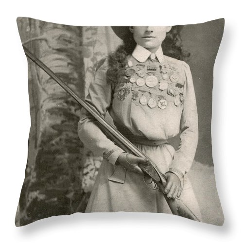 Annie Oakley Throw Pillow featuring the photograph Annie Oakley With A Rifle, 1899 by Richard Kyle Fox