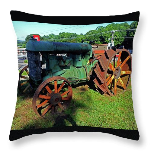 Hurricane Mills Throw Pillow featuring the photograph Antique Tractor 3 by Ron Kandt