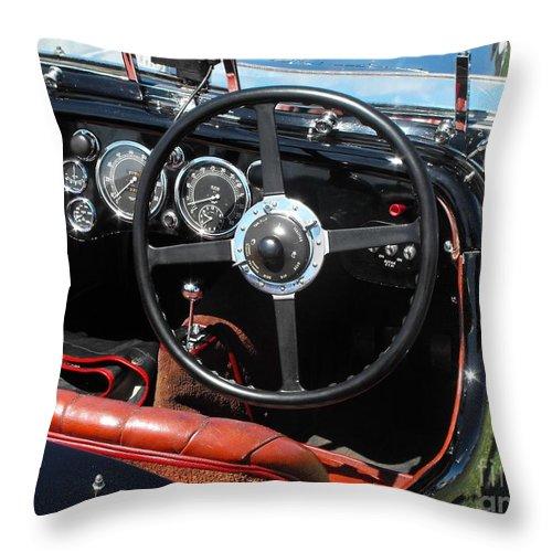 Aston Martin Throw Pillow featuring the photograph Aston Martin Dashboard by Neil Zimmerman