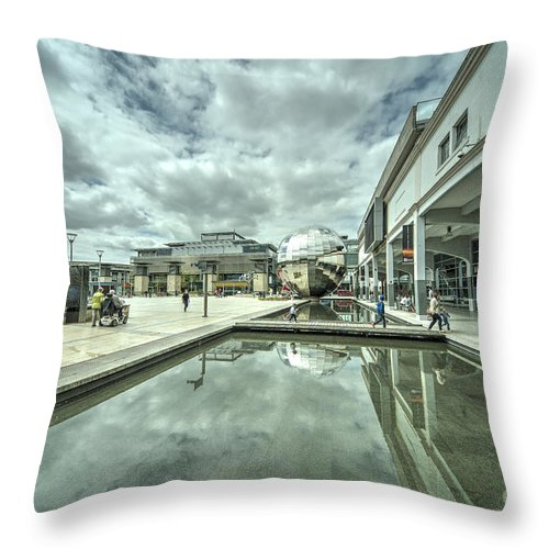 Bristol Throw Pillow featuring the photograph at Bristol by Rob Hawkins