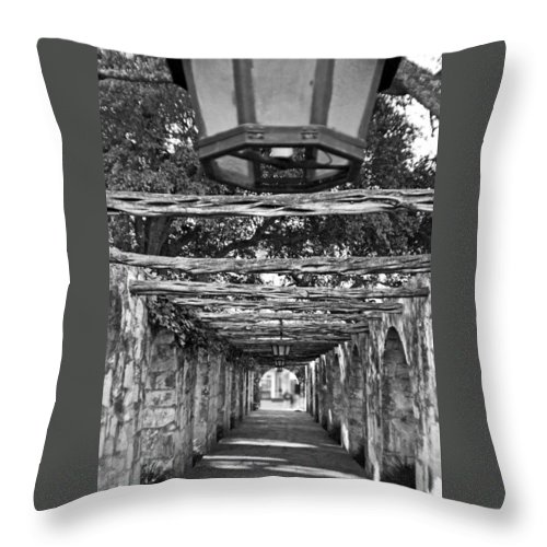 Alamo Throw Pillow featuring the photograph At The Alamo by Greg Sharpe