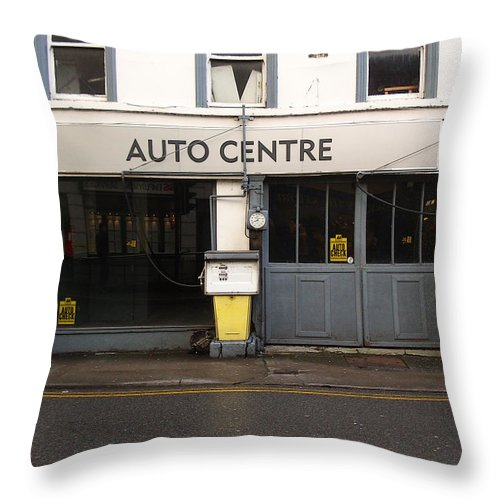 Auto Throw Pillow featuring the photograph Auto Centre by Tim Nyberg