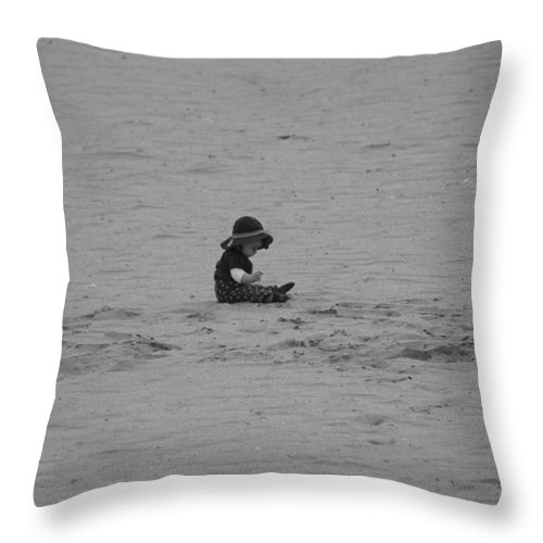 Black And White Throw Pillow featuring the photograph Baby In The Sand by Rob Hans