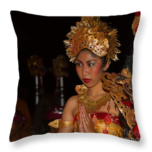 Dancer Throw Pillow featuring the photograph Balinese Dancer by Louise Heusinkveld