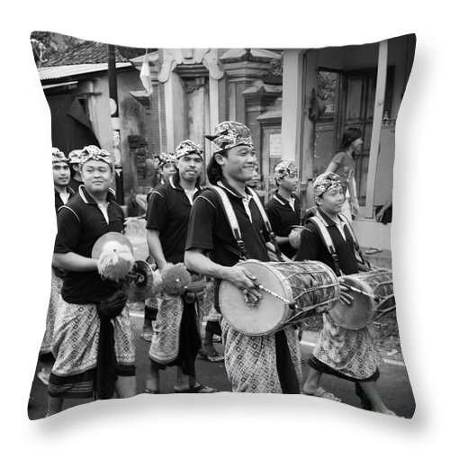 Balinese People Throw Pillow featuring the photograph Balinese People by Charuhas Images