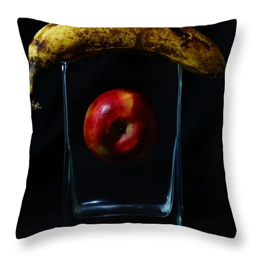 Color Photography Throw Pillow featuring the photograph Banana Over Apple by Kirk Griffith