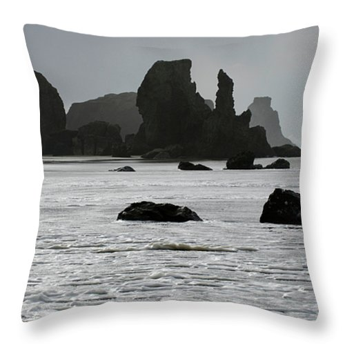 Rocks Throw Pillow featuring the photograph Bandon Silouettes by Bob Christopher