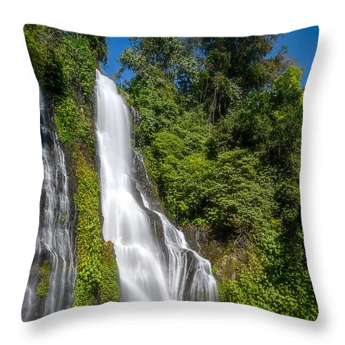 #waterfall #green #water #fresh #landscape #bluesky #sky Throw Pillow featuring the photograph Banyumala Waterfall by Sugianto Art Photography