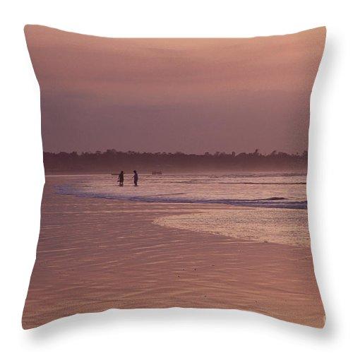 Ecuador Throw Pillow featuring the photograph Beachcombers by Kathy McClure