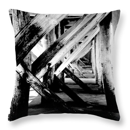 Black Throw Pillow featuring the photograph Beneath The Docks Night by Jamie Lynn