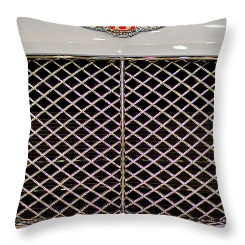 Bentley Throw Pillow featuring the photograph Bentley Grille And Insignia by Stuart Litoff